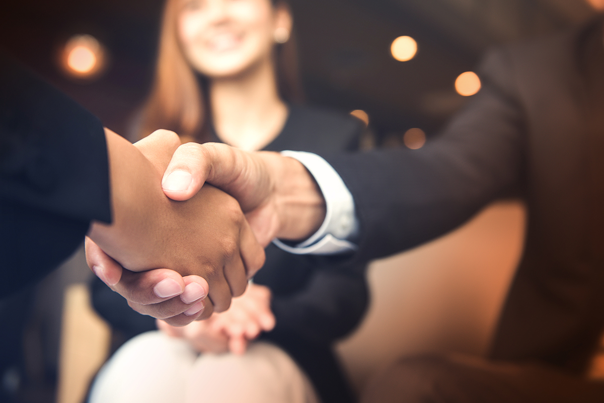 people_working_handshake_image4_opt1200px
